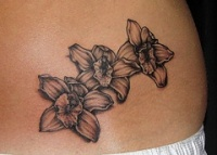 Black orchid flowers tattoo