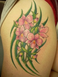 Orchid flowers in greens tattoo