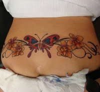 Lower back orchid with butterfly tattoo