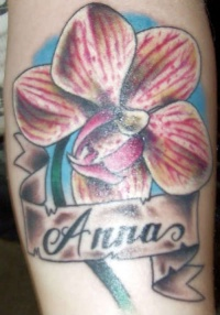 Name and orchid flower tattoo