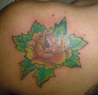 Yellow carnation flower tattoo