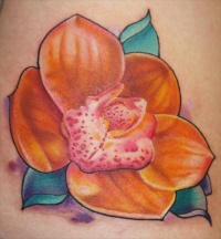 Yellow orchid flower tattoo