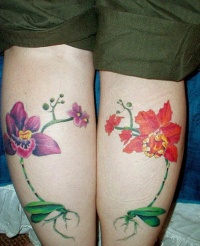 Orchid flower tattoos on both legs